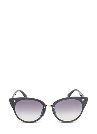 Behind These Cat Eye Sunglasses