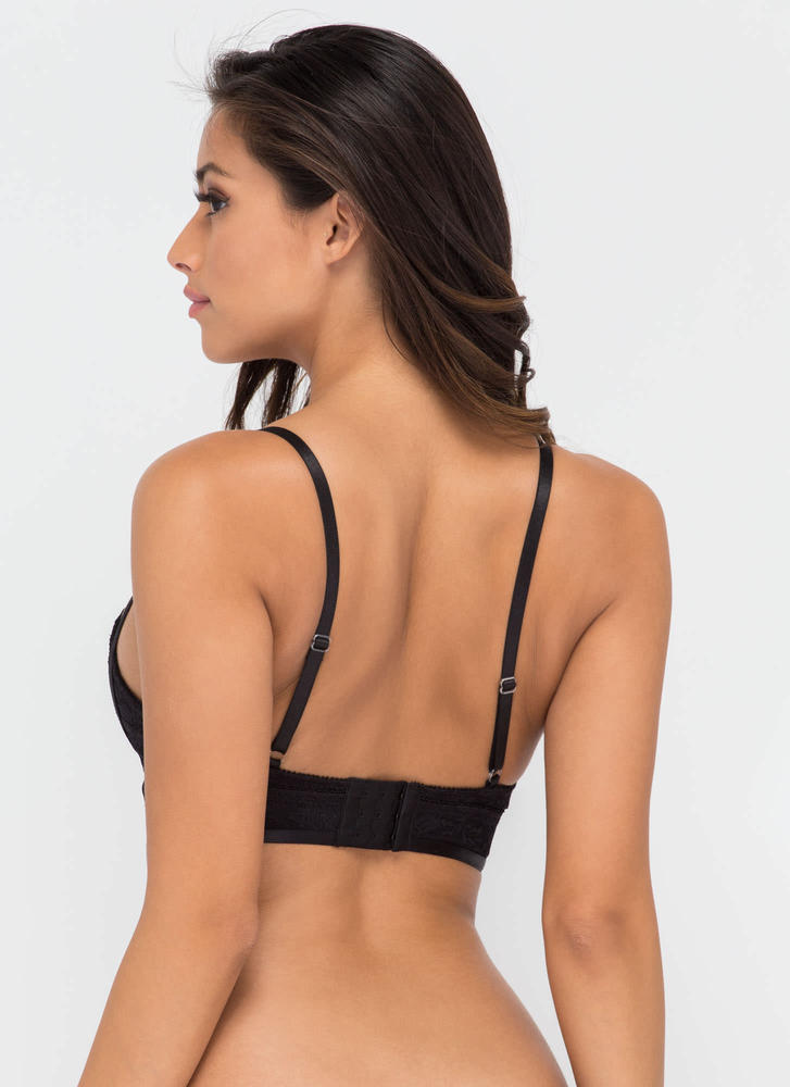 Keep your night-out looks interesting and sexy the moment you wear this flirty black lace strappy bustier crop top.